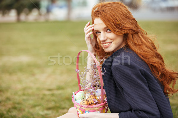 Girl with long hair holding easter picnic basket Stock photo © deandrobot