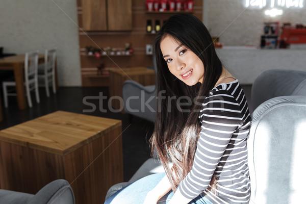 Oldalnézet ázsiai nő ül büfé pulóver Stock fotó © deandrobot