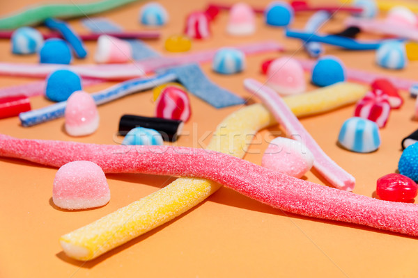 Mixed colorful candies jellies on the pink background Stock photo © deandrobot