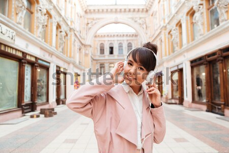 Stock photo: Girl talking on mobile phone while standing at the street