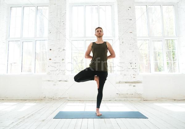 Moço ioga pilates exercer fitness Foto stock © deandrobot