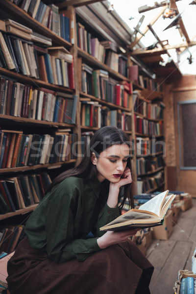 Pretty girl reading book in library Stock photo © deandrobot