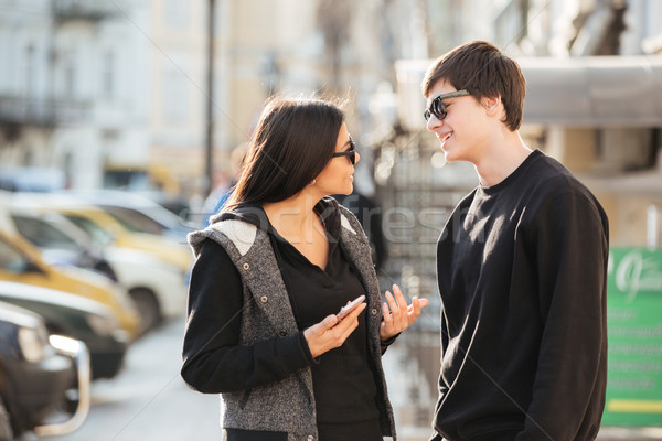 Woman walking outdoors with her brother. Stock photo © deandrobot