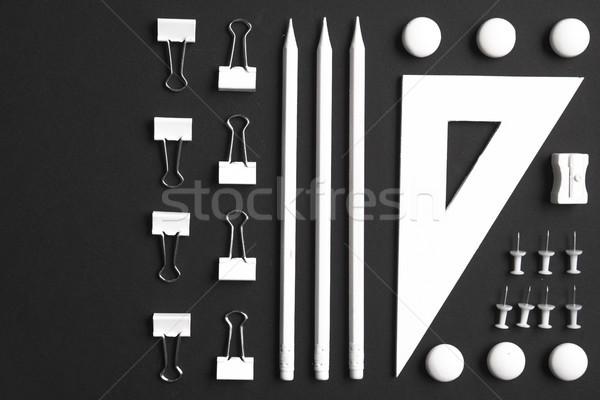 Felső kilátás kép irodaszerek fekete asztal Stock fotó © deandrobot