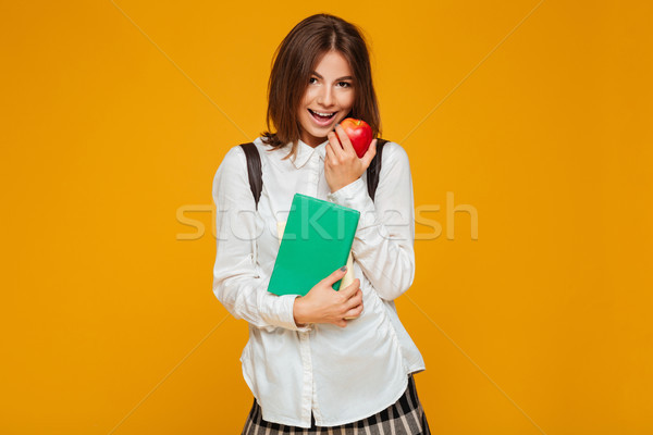 Portrait of a pretty schoolgirl holding books Stock photo © deandrobot