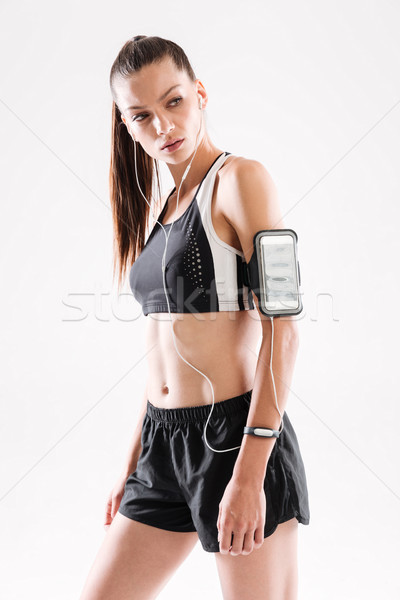 Portrait of a concentrated young fitness woman in sportswear Stock photo © deandrobot