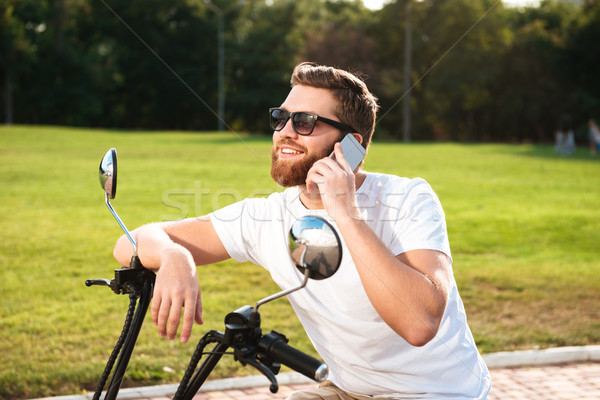 Side view of smiling bearded man in sunglasses Stock photo © deandrobot