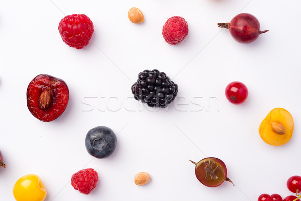 Keverék bogyók izolált fehér asztal kép Stock fotó © deandrobot
