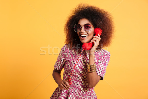 Portrait of a smiling happy afro american woman Stock photo © deandrobot