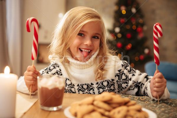 Komik küçük kız iki şeker dil Stok fotoğraf © deandrobot