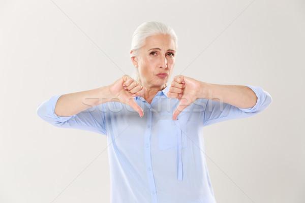 Niezadowolony poważny staruszka kciuk w dół Zdjęcia stock © deandrobot