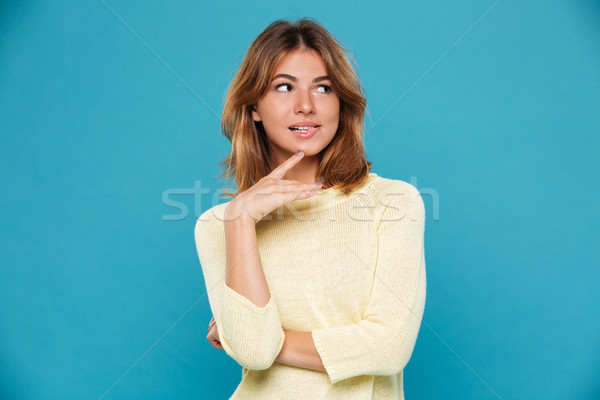 Mystery playful woman in sweater bites her lip Stock photo © deandrobot