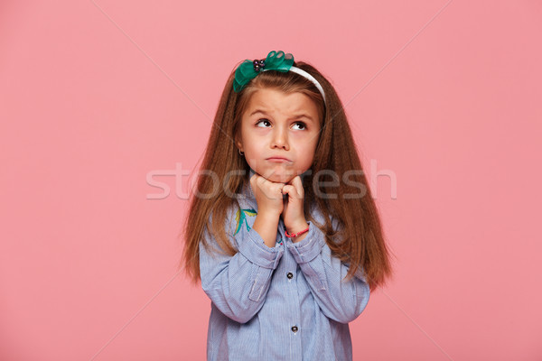 Close up photo of adorable schoolgirl 5-6 years propping up her  Stock photo © deandrobot