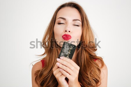 Portrait of a smiling brown haired woman Stock photo © deandrobot