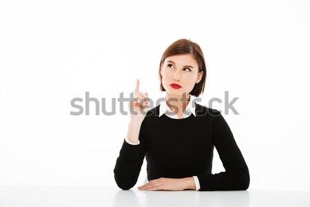 Surpreendente sério jovem mulher de negócios indicação imagem Foto stock © deandrobot