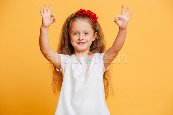 Funny little girl child showing okay gesture. Stock photo © deandrobot