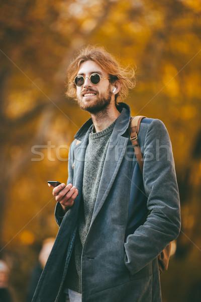 Portré mosolyog szakállas férfi fülhallgató visel Stock fotó © deandrobot