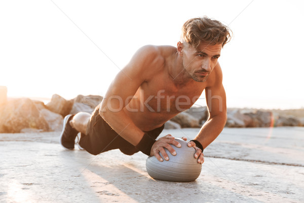 Portrait of a focused shirtless sportsman Stock photo © deandrobot