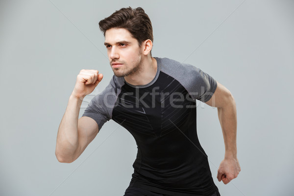 Portrait of a serious young sportsman ready to run Stock photo © deandrobot