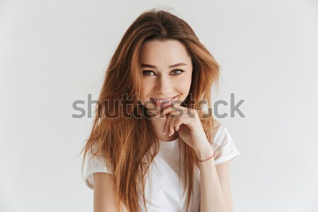 Mystery smiling woman in t-shirt posing with arm near face Stock photo © deandrobot