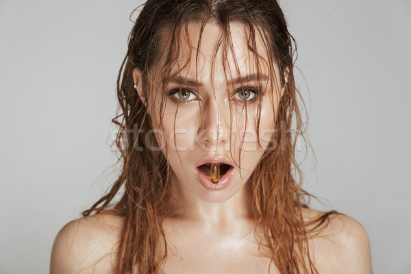 Fashion portrait of a topless pretty woman Stock photo © deandrobot