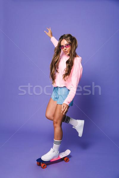 Full length portrait of a pretty girl in sweatshirt Stock photo © deandrobot
