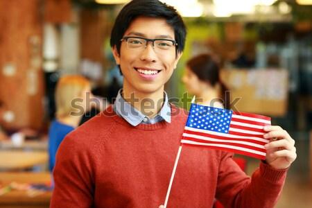 Boldog ázsiai fiú szemüveg tart zászló Stock fotó © deandrobot