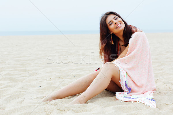 Young beautiful woman wrapped herself with blanket on the beach Stock photo © deandrobot