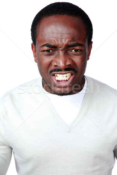 Portrait of angry african man isolated on white background Stock photo © deandrobot