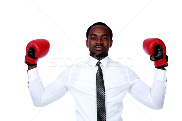üzletember boxkesztyűk kiemelt kéz fehér üzlet Stock fotó © deandrobot