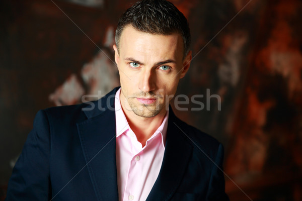 Portrait of a fashion man over industrial background Stock photo © deandrobot