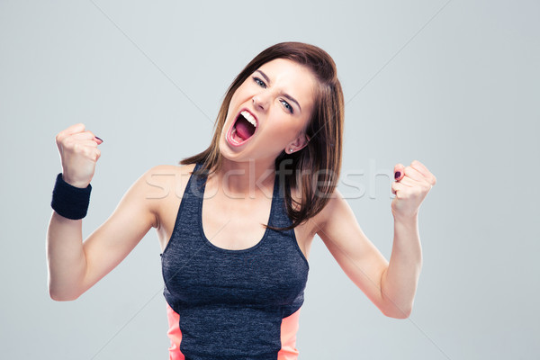 Angry young sports woman shouting Stock photo © deandrobot