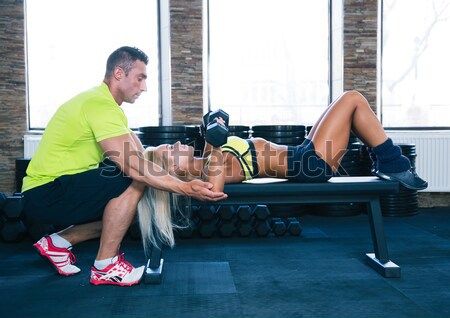 Muscular hombre flexiones mujer atrás guapo Foto stock © deandrobot