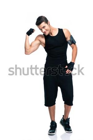 Boldog fitnessz férfi mutat bicepsz teljes alakos Stock fotó © deandrobot