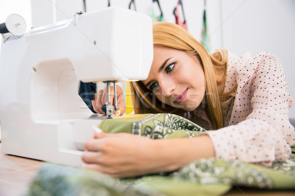 Stock photo: Female tailor using sewing machine