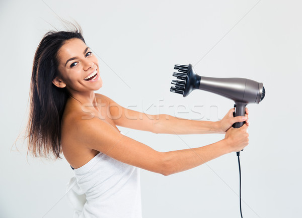 Laughing woman in towel drying her hair  Stock photo © deandrobot
