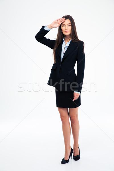 Beautiful businesswoman saluting Stock photo © deandrobot