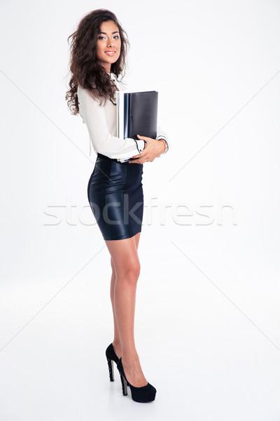 Empresária em pé dobrador retrato sorridente Foto stock © deandrobot