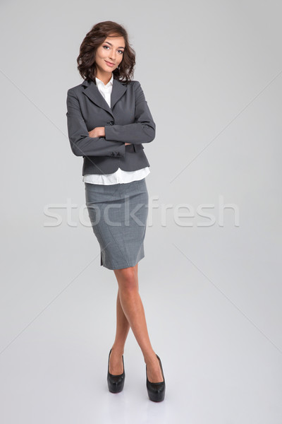 Full lenght portrait of business woman on white background Stock photo © deandrobot