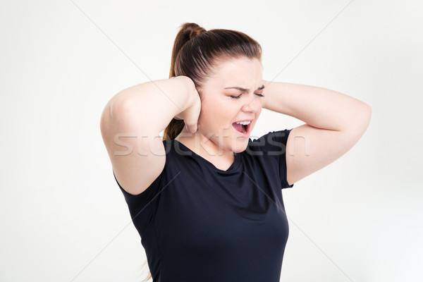 Fat woman in sportswear covering her ears and shouting Stock photo © deandrobot