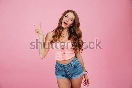 Gelukkig mooie jonge vrouw tonen beide Stockfoto © deandrobot