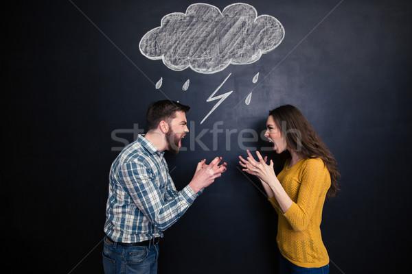 Casal em pé quadro-negro gritando família Foto stock © deandrobot