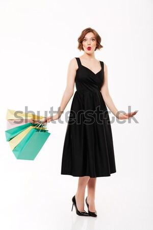 Femme souriante séance cheveux longs cute souriant Photo stock © deandrobot