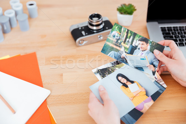 Photos of models holded by woman photographer at the table Stock photo © deandrobot