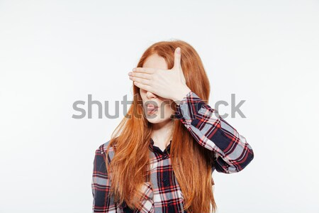 Woman covering her eyes and showing tongue Stock photo © deandrobot