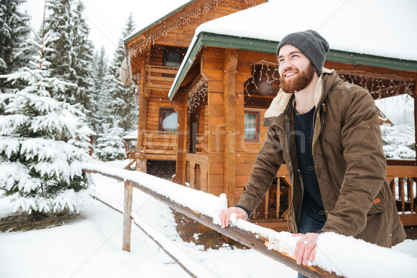 Vrolijk man permanente houten huisje winter Stockfoto © deandrobot