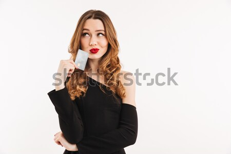 Gorgeous woman demonstrating red lipstick on half of her lips Stock photo © deandrobot