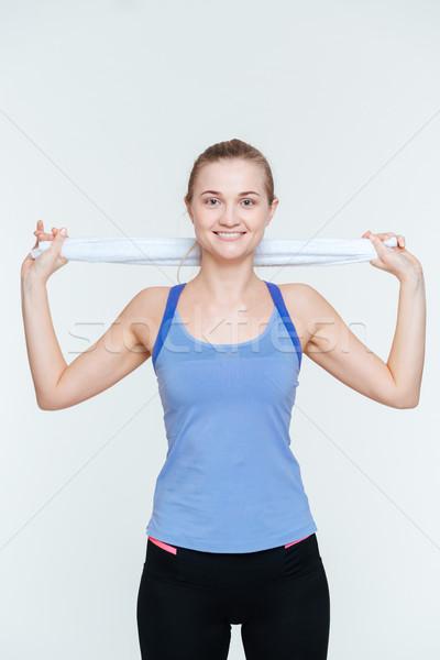 Happy fitness woman holding towel Stock photo © deandrobot