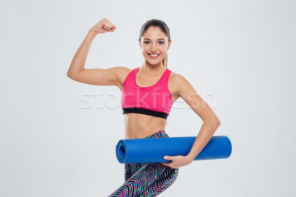 Mujer de la aptitud estera de yoga bíceps feliz Foto stock © deandrobot