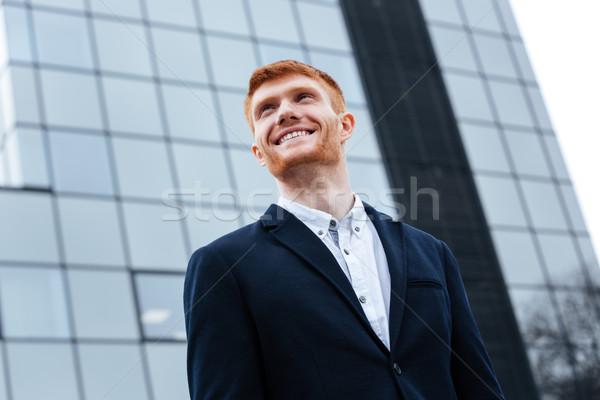 Stockfoto: Zakenman · buitenshuis · glimlachend · glazen · gebouw · gebouw